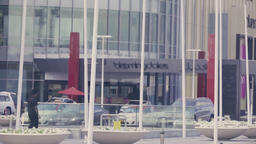 Arabian mall modern exterior Dubai city street road HD video. Traffic entrance Footage