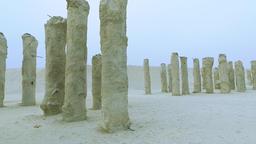 POV walking through mystery columns sand desert HD video. Ancient temple ruin