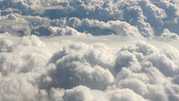 Cloudscape HD nature aerial video background. Flying above clouds from air plane Footage