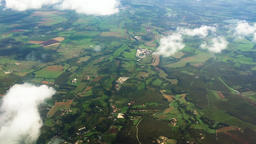 Flying over countryside village terrain aerial HD video. Top view land: fields Footage