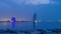 Sunset of Dubai cityscape twilight skyline HD timelapse video. Burj al-Arab Footage