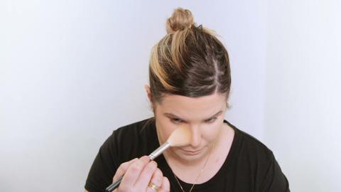 Beautiful young woman applying makeup Footage