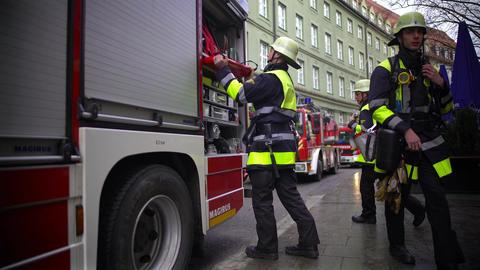Firefighter putting equipment into firetruck, dangerous job, responsibilities Footage