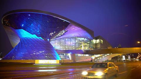 Creative illumination on modern building, contemporary design, rainy evening Footage
