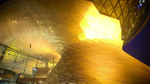 Huge all glass business center in the evening, beautiful illumination, panorama Footage