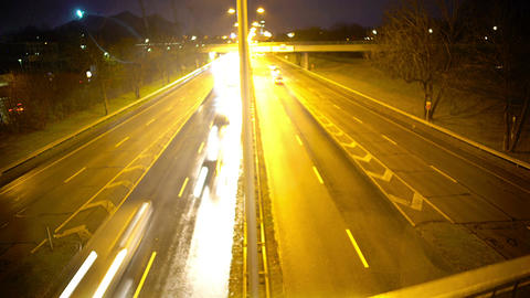 Automobiles driving fast on highway at night, risk of accident, rainy weather Footage