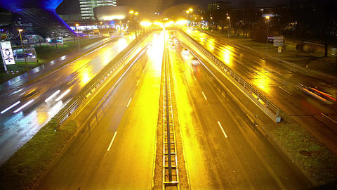 Night city life, cars driving on highway near modern shopping center, timelapse Footage