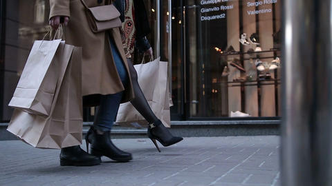 Young women walking with bags after shopping Footage