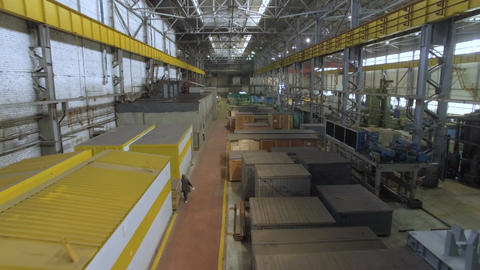 Drone Flies Through Large Industrial Facility with Machines Footage