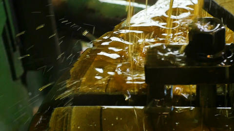 Closeup Cooling Grease Streams Flow down Lathe Machine Footage