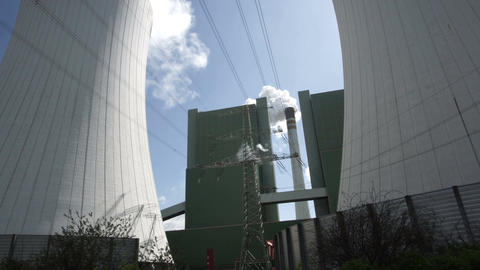 Industrial Installation With Smoke Stack and Cooling Tower Closeup Tilt Up Footage