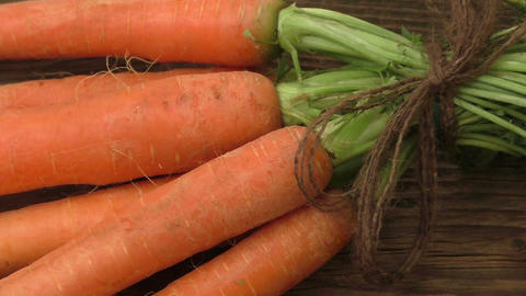 Fresh carrots bunch on rustic wooden background Footage