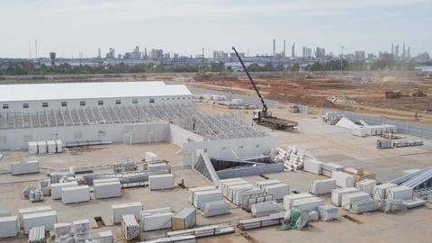 Aerial Motion Over Construction Site with Blocks and Crane Footage