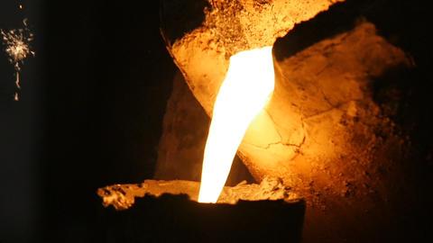 Wonderful View Red Hot Liquid Metal Flows in Darkness Footage