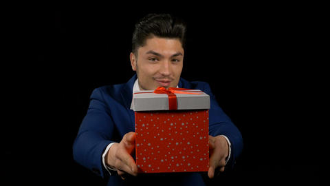 Attractive business man offering a birthday gift Footage