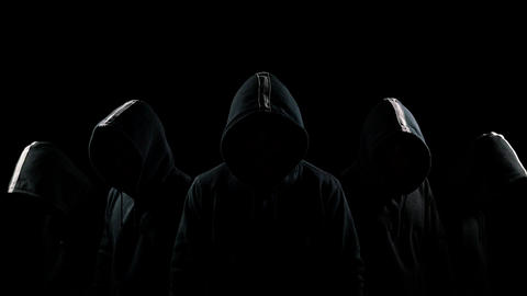 Five mysterious hooded men standing in the dark hoodies and hidden faces Footage