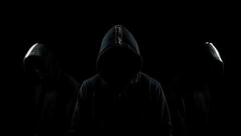 Faceless mysterious hooded individuals Stock Video Footage