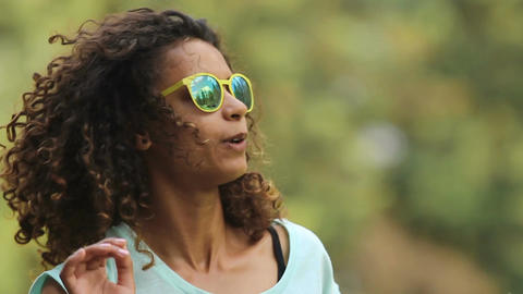 Cute biracial woman having great time, dancing to song and singing along to it Footage