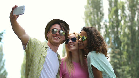 Several close friends hugging, taking selfies and laughing at outdoor party Footage