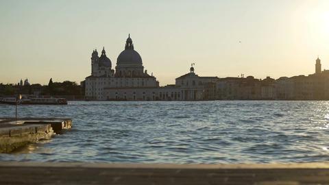 Saint Mary of Health church dome on Venice skyline at dusk, vacation in Italy Live Action