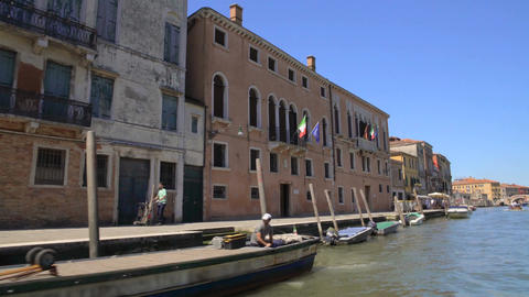 Motorboats moored along canal, old architecture in streets of Venice, tourism Footage