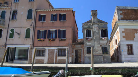 Beautiful elegant decay architecture of Venice, motorboats moored along street Footage