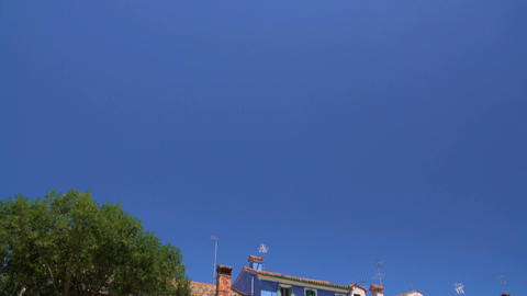 Beautiful deep blue sky above shabby colored houses, Burano island, Venice Footage