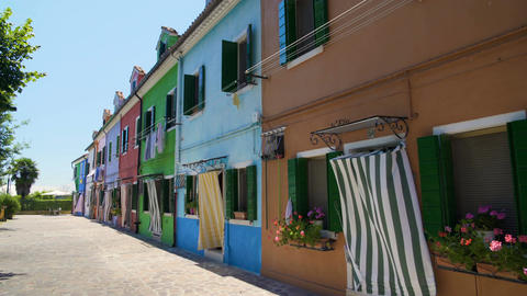 Beautiful street with brightly colored houses, famous Burano island architecture Footage
