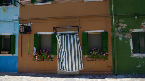Tidy brown house with nice flower pots on windows, cozy Italian architecture Footage