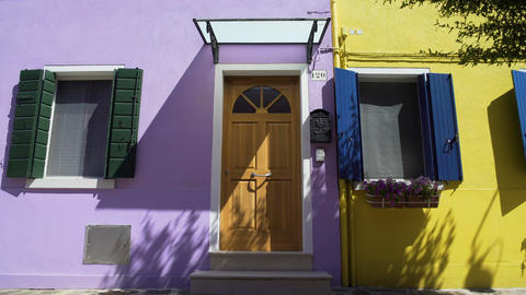 Bright lilac and yellow houses with sweet flowers on windows, cozy neighborhood Footage