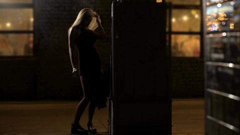 Seductive lady dancing and smoking near night club, bad habits, alcohol abuse Footage