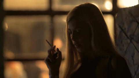 Blonde woman with perfect body enjoying cigarette smoke, night life, relaxation Footage