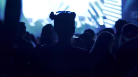 Female silhouette dancing and enjoying music at nightclub, nightlife in big city Footage