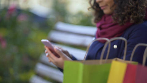 Woman scrolling pages on smartphone, choosing items online, mobile shopping Footage
