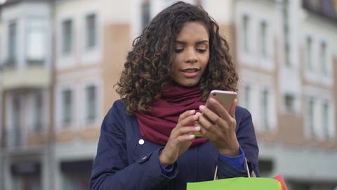 Stylish woman looking for clothes, actively surfing online stores on smartphone Footage