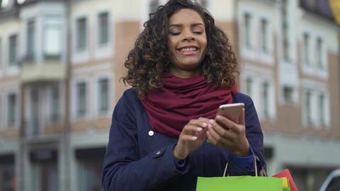 Mixed race woman checking online store apps on modern smartphone, shopping Footage