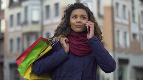 Woman with shopping bags calling female friends to tell about discounts in shops Footage