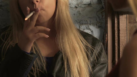 Blonde girl smoking while listening to her best friend talking about her problem Footage