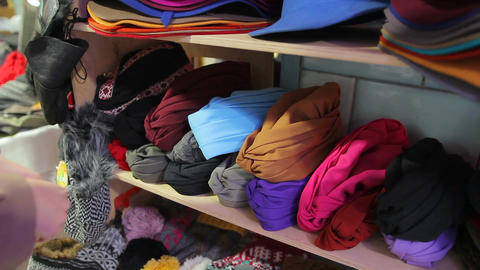 Female customer choosing colored turban at local market, shopping, latest trends Footage
