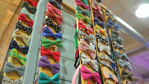 Woman choosing handmade bow-tie among huge variety at handcraft store, fashion Footage
