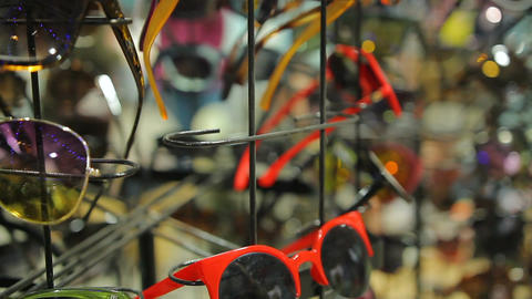 Accessories sale at local department store, female customer choosing sunglasses Footage