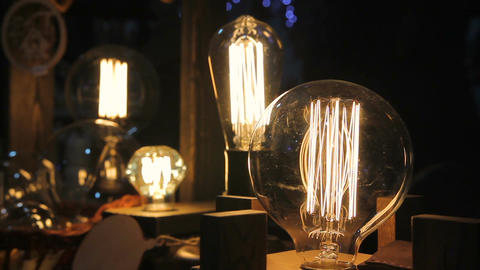 Collection of decorative Edison light bulbs, vintage objects, creative design Footage