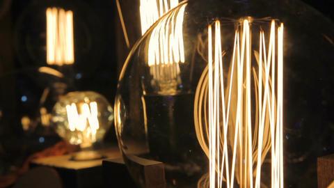 Flickering filament inside decorative Edison light bulbs, design, creativity Footage