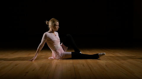 Ballerina dancer warming up training and exercising before show Footage