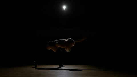 Beautiful sexy silhouette dancer girl rehearsing Footage