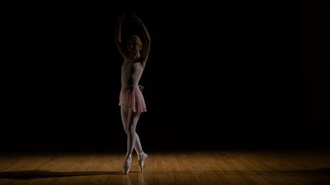 Attractive ballerina girl dancing in her tutu Footage