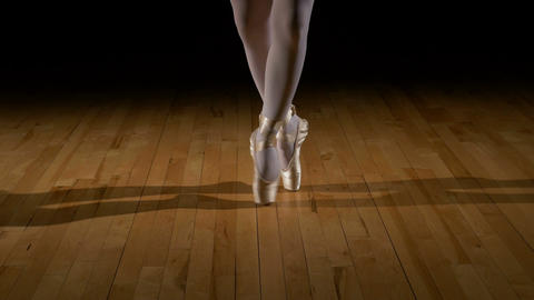 Close-up feet of a dancing ballerina wearing pointes shoes Footage