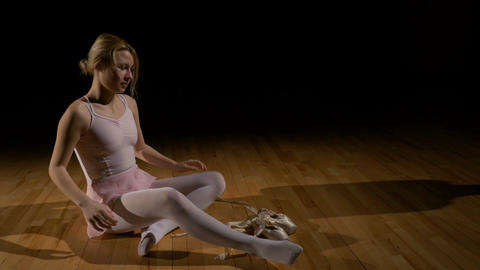 Tired ballet dancer illustrating concept of hard work in achieving dreams Footage