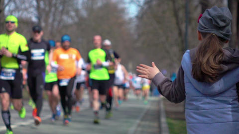 Video of giving runners high five in real slow motion Footage