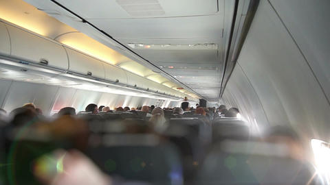 The flight attendant goes through the cabin Footage